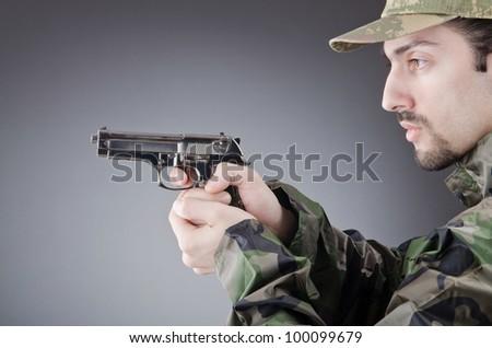 Soldier with gun in studio shooting