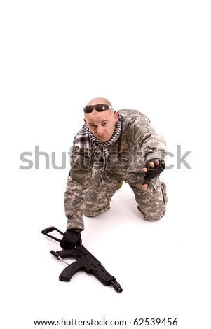 soldier with hands up, isolated in white