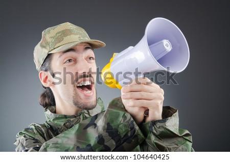 Soldier with loudspeaker shouting