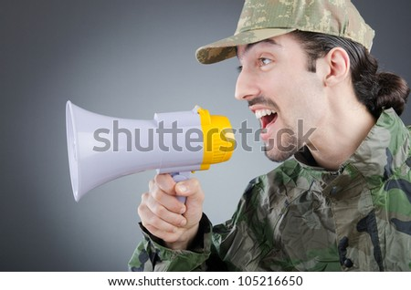 Soldier with loudspeaker shouting