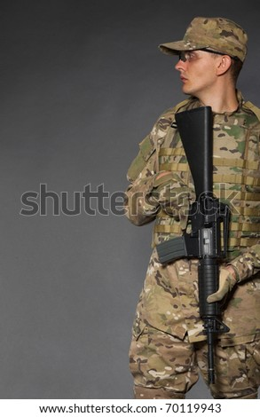 Soldier with rifle on a black background