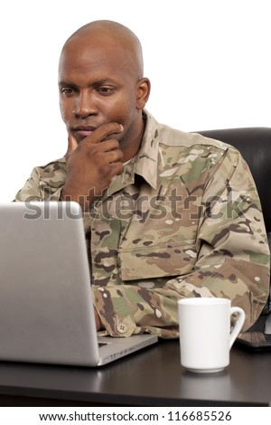 Soldier working on a laptop