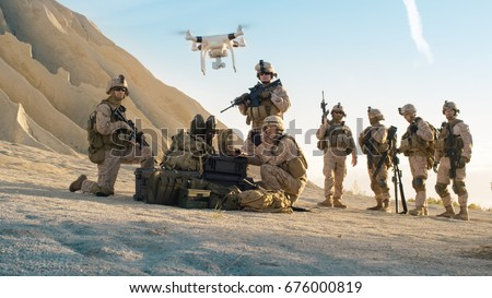 Soldiers are Using Drone for Scouting During Military Operation in the Desert.