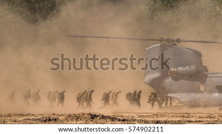 Soldiers boarding a military helicopter.