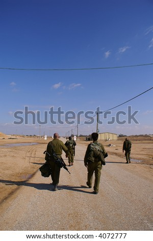 Soldiers exercise - walking in uniform with weapon