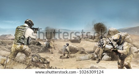 Soldiers fighting on desert scene. Photo of a soldiers fighting and atacking on a desert battlefied background. #1026309124