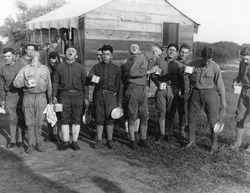Soldiers gargle with salt and water to prevent influenza. Sept. 24, 1918. Camp Dix, New Jersey, during the 1918-19 'Spanish' Influenza pandemic.
