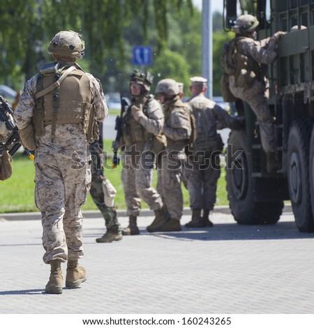 Soldiers in full gear patrol