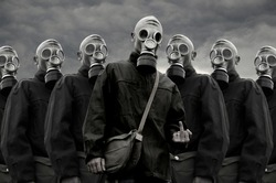 Soldiers in gas mask against stormy sky