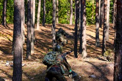 Soldiers reconstructing fights in the forest
