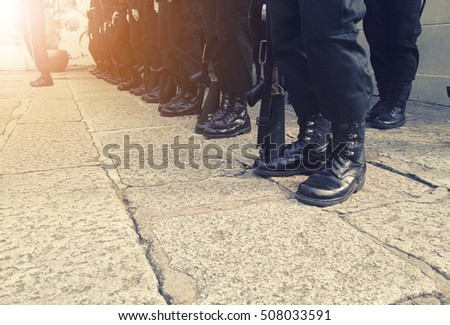 soldiers stand in line to...