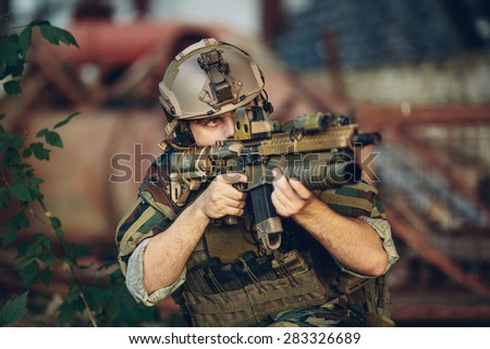 soldiers to aim and shoot at a target with automatic weapons