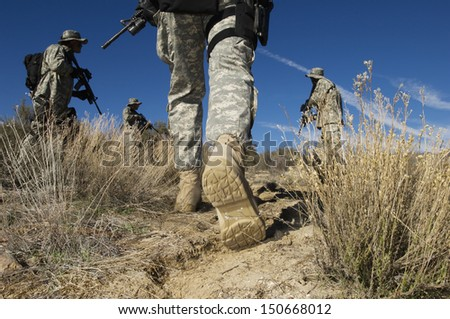 Soldiers walking in desert, low section #150668012