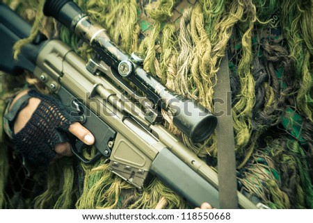 soldiers with assault rifle with telescopic view and camo suit