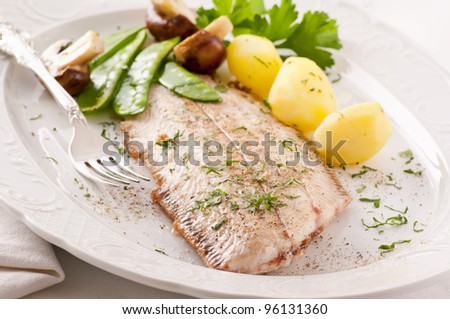 sole fried with potato and mushrooms