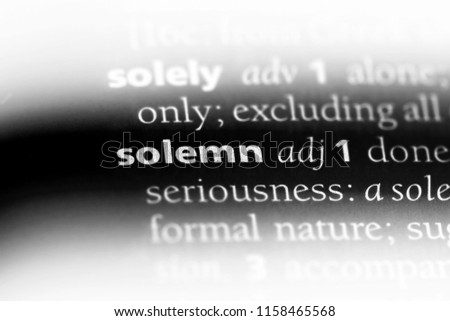 solemn word in a dictionary. solemn concept.