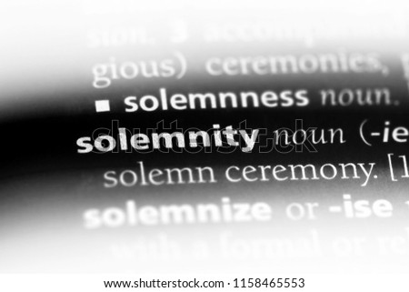 solemnity word in a dictionary. solemnity concept.