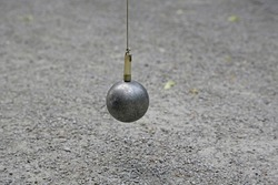 Solid metal ball put up with a magnet from the gravel traditional game boule bowls pétanque played in the Munich court garden Hofgarten