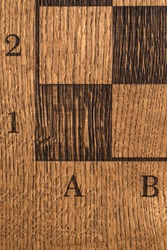 Solid Oak wood chess board from above, close up