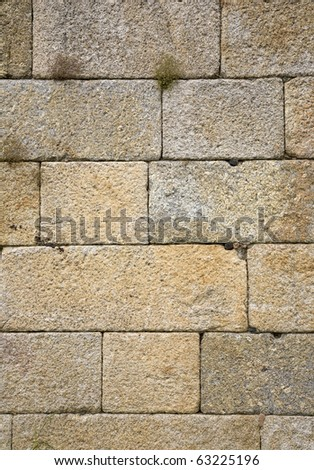 Solid old stone wall, made of large blocks of basalt rock, at the Douro valley, home of the port wine region, Portugal