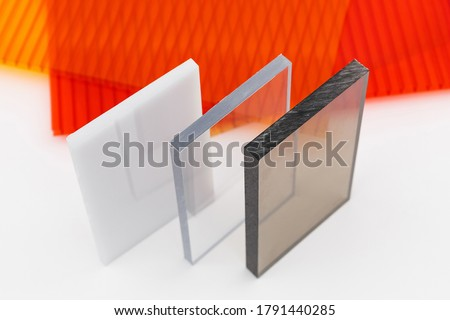 Solid Polycarbonate Sheet. Brown and transparent. Acrylic Plastic glass. Colored pc sheet on background Stock photo ©