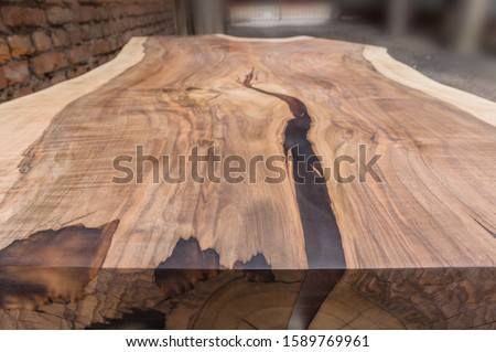 Solid walnut wooden table with epoxy resin filling Photo stock ©