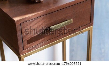 Solid wood furniture. Wooden curbstone with metal legs, bronze color. Hallway furniture, housekeeper. Neoclassicism.