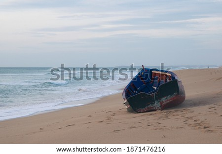 Solitary and abandoned immigrant dinghy patera boat at the Atlantic coast of south Spain Foto stock ©