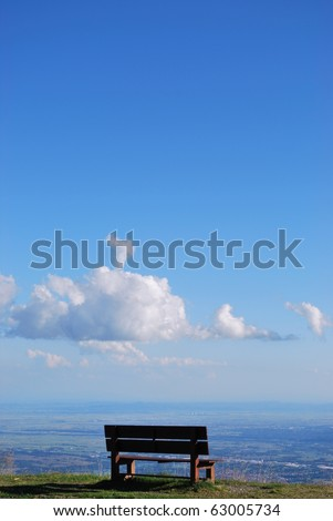 Solitary bench with breathtaking panoramic view on Po valley from Bielmonte, Piedmont, Italy, free copy space