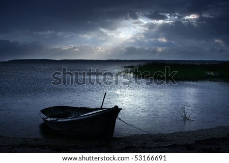 Solitary Boat in the rain