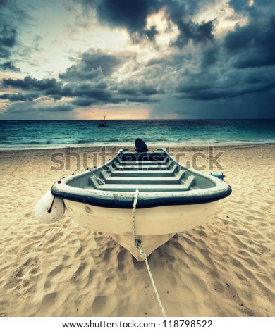 Solitary boat on Bavaro beach in Punta Cana, Dominican Republic