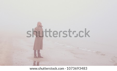solitary man with beard and...