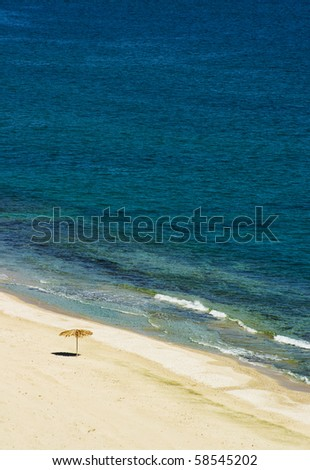 solitary sunshade on a sandy beach