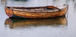 Solitary wooden rowing boat