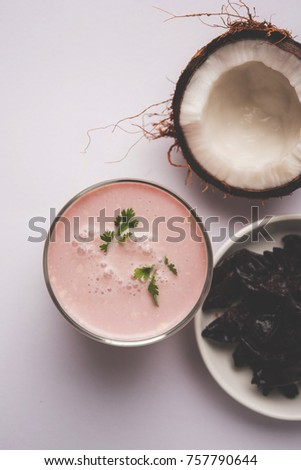 Solkadhi OR Kokum curry, A famous drink from Goa or Maharashtra`s Konkan region, served in a glass over moody background, selective focus