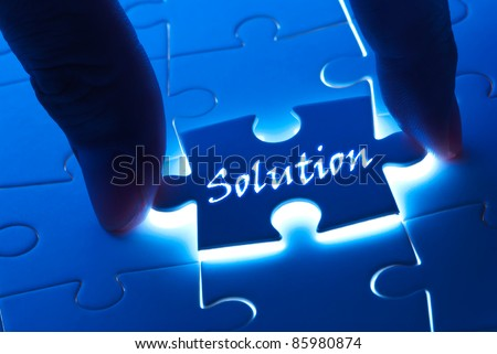 Solution concept, solution word on puzzle piece with back light