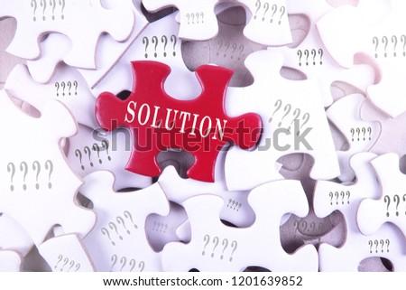 Solution concept, solution word on puzzle piece with question marks. #1201639852