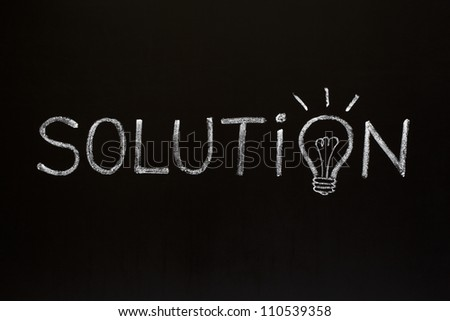 Solution concept with chalk drawn light bulb on the place of the letter O on blackboard.