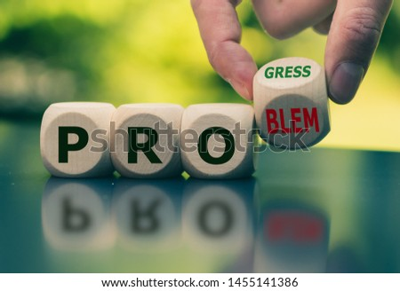 """Solving a problem and making progress. Hand flips a cube and changes the word """"problem"""" to """"progress"""". #1455141386"""