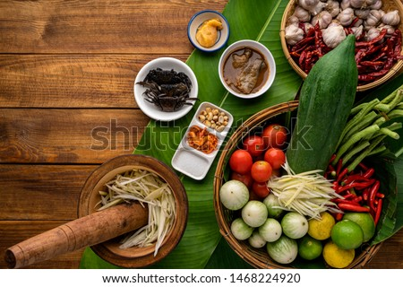 Som Tam Thai -Ingredients Papaya Salad Thai Food Style on wooden table background. Thai Food Concept. Top View