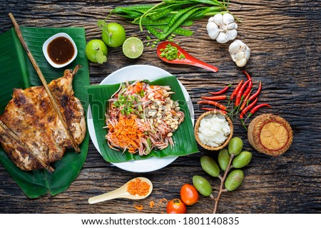 """Som Tam Thai -Ingredients Papaya Salad Thai Food Style ,Thai Salad, """"Somtum"""" cuisine, Background, Lao, Southeast Asia, somtam, green papaya, sweet, salty, tangy, and spicy Thai Food Concept. Top View"""