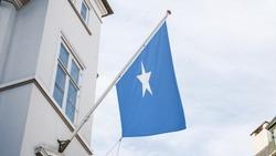 Somalia Flag outside building for advertising, award, achievement, festival, election. National Flag of Somalia waving on Pole