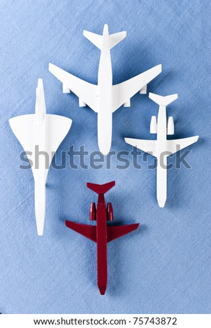 some airplanes in one roe on blue background
