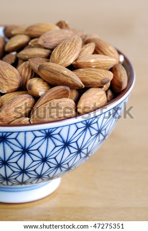 Some almonds on a small Japanese bowl