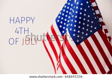some american flags and the text happy 4th of july against an off-white background