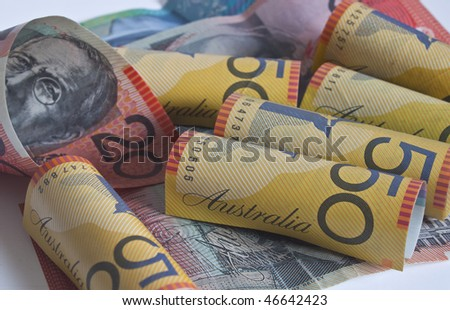 some australian dollars rolled up - stock photo