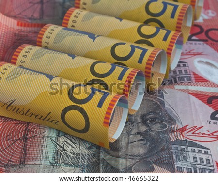 some australian dollars with the fifty dollar bill rolled up