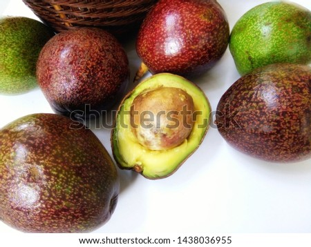 Some avocado species that can be grown in Chiang Mai, Thailand, have an oval fruit with relatively large seed, thin flesh and creaminess,when riped has reddish-brown peel,light yellow meat.Thailand.