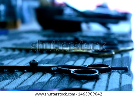 Some barber scissors on a barber's workbench