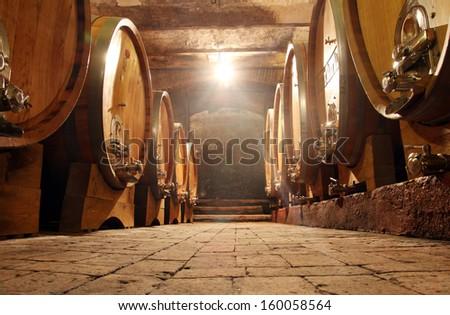 Some barrels in a  cellar